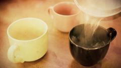 Three cups hot water one tea antique Stock Footage