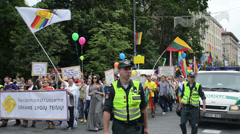 Gay parade members triumph with flags flying balloons posters Stock Footage