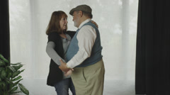 Retired Couple Dancing at Home Stock Footage