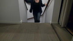 Woman falling on stairs at home, domestic accident, knee pain, injury Stock Footage