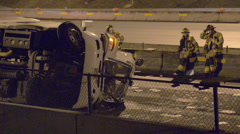 Emergency Scene Of Fire And Rescue Responding To A Semi And Trailer Flipped Over - stock footage