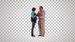 Male & female stand and talking (on alpha matte) Stock Footage