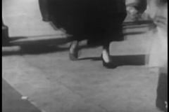 Low section of woman walking on street, 1950s Stock Footage