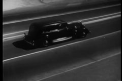 Montage of car veering off road and falling off cliff, 1930s Stock Footage