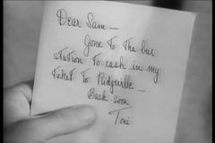 Close-up of  person reading short note, 1940s Stock Footage