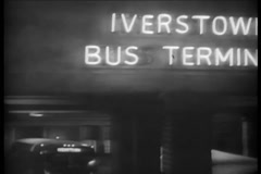 Wide shot of busy bus terminal at night, 1940s Stock Footage