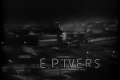 High angle view of town with man running on railroad tracks, 1940s Stock Footage