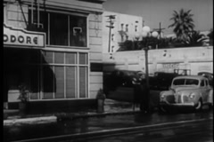 Car pulling up in front of  the New Commodore Hotel, Los Angeles, 1940s Stock Footage