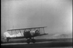 Biplane taking off, 1930s Stock Footage
