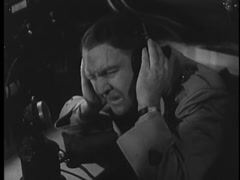 Man unable to communicate with radio operator during storm, 1930s Stock Footage