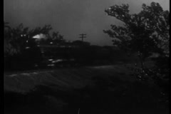 Locomotive traveling across countryside at dawn, 1940s - stock footage