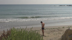 Handsome man talk mobile phone ocean sea beach exotic tropical paradise place  Stock Footage