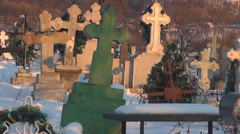 Cemetery cross covered snow winter season rural countryside grave tomb stone day - stock footage