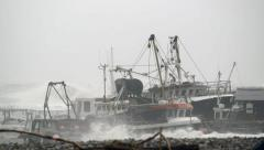 Boats battered by waves and wind during storm Stock Footage