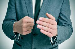 man in suit with a threatening gesture - stock photo