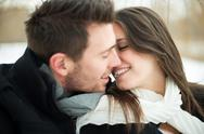 Stock Photo of Young couple being affectionate in winter