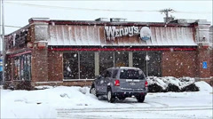 Snowy Wendy's restaurant front Stock Footage