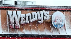 Snowy Wendy's sign Stock Footage