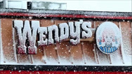 Stock Video Footage of Snowy Wendy's sign