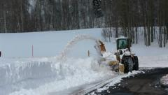 Snow blower high mountain road forest HD 2306 Stock Footage