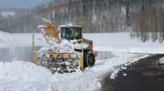 Snowblower breaks clearing snow mountain road HD 2320 Stock Footage