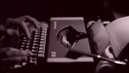 Stock Video Footage of An Author Writing a Book on a Vintage Typewriter, Black and White