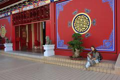 Tourist resting on the stair of chinese buddhist temple, bandar seri begawan, Stock Photos