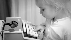 Cute Baby Girl Writing a Book on a Vintage Typewriter, Black and White Stock Footage