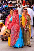 indian women standing at sadar market, jodhpur, india - stock photo