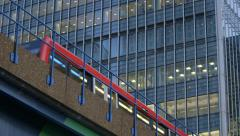 Commuter Train passes Office - Canary Wharf, London - stock footage