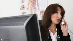 Female doctor in her office Stock Footage