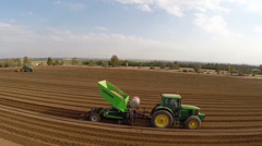 Tractor works on the Potato field Stock Footage