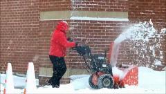 Man operates snowblower Stock Footage