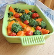 Casserole with broccoli,cherry tomatoes and carrots Stock Photos