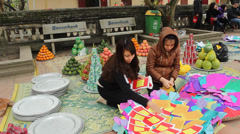 Woman preparing gifts for the dead in asia Stock Footage
