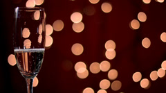 Champagne pour into glass with bubbles Stock Footage