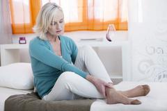 Ankle pain in a senior Stock Photos