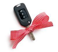 Car key with ribbon Stock Photos