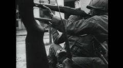 WW2 - Soldiers Firing 01 - Walk Along Beach Stock Footage