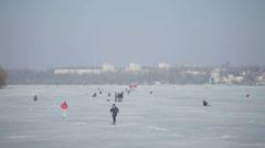 People walking on a frozen lake ii Stock Footage