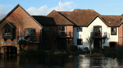 The English floods 2014 (row of homes flooded - zoom) Stock Footage