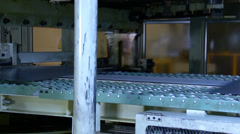 Machine is cutting sheet metal in automobile factory Stock Footage