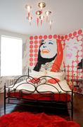 nice bedroom with red accessories - stock photo