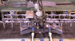 Pressing sheet metal in automotive factory - stock footage