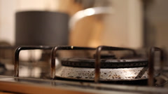 Pan placed on gas hob Stock Footage