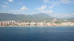 View to sea, mountain and coastline with hotels from parachute Stock Footage