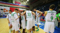 White team discusses the game after teams play basketball Stock Footage