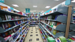 Horizontal movement in library with long bookcase and many books Stock Footage