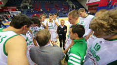 White team talk with coach after teams play basketball Stock Footage