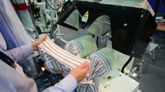 A man checks operation of the machine for ironing shirts Stock Footage